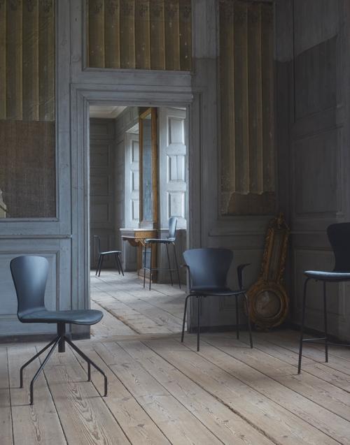 Silla negra Swing. Designers in-home. Muebles de diseño y decoración, accesorios para el hogar. Encuentra estilo en tu tienda de decoración